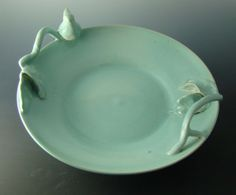 Large pottery serving bowl with branches and bird
