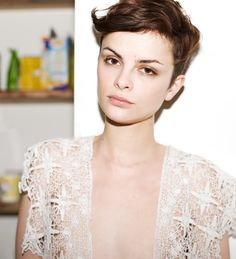 such a girly delicate lacy top contrasted with close cropped hair and delicate features.