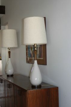 Pair of Mid-Century Modern White Ceramic and Wood Lamps  with Lamp Shades ... I love the entire vignette