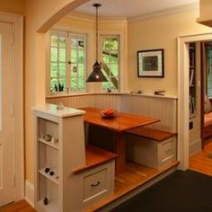 A Table And Builtin Bench Create This Cheerful Breakfast Nook - Breakfast nook storage table