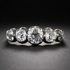 This ultra-rare, original early-to-mid-19th century Georgian diamond ring glitters across your finger with five gorgeous old mine-cut diamonds - together weighing 2.00 carats. The bright-white quintet sparkles from within silver-topped, closed back 18 karat gold settings. This special ring is a finger size 8 3/4 and cannot be sized. To be worn gently and with care.