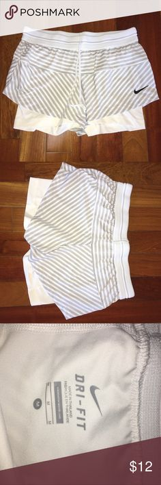 NIKE Dri-Fit White & Gray Shorts, size Medium Nike Dri-Fit Shorts with built in compression shorts and drawstring, white and gray, size medium, great used condition Nike Shorts