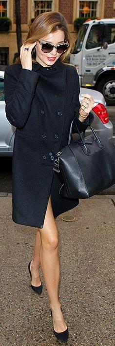 Who made  Miranda Kerr's black coat and black leather handbag that she wore in New York on December 7, 2012?