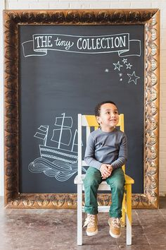 """Tiny model for """"The Tiny Collection"""" children's clothing line poses perfectly in front of our oversized chalkboard frame.  Too Cute! *Paisley & Jade vintage & Eclectic Furniture Rentals for Events, Weddings, Theatrical Productions & Photo Shoots*"""