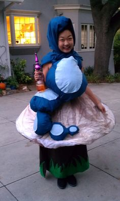 "the Blue Caterpillar from Alice in Wonderland.  my 12 yr old's homemade Halloween costume 2012.  caterpillar chillin' on a mushroom holding her ""bottle of bubbles"" (couldn't have her walk around with a hookah).  she blew bubbles as she said, ""whoooooo are youuuuu?"""