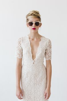 A bit daring with the neckline but the clean lines make for a beautiful contemporary casual wedding dress.