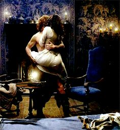 He lifted her easily, carrying her to the old bed she had dragged into her crumbling castle years ago. Their lips never left one another's.