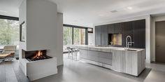 Bright white kitchen, dark windows, contemporary lines, modern _ Culimaat - High End Kitchens | Interiors | ITALIAANSE KEUKENS EN MAATKEUKENS - BloxX