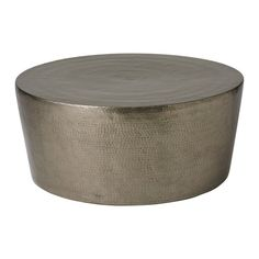 Hand hammering brings out rich detail of the nickel-plated solid brass sheet in the Izmir Coffee Table.
