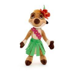 """Ahora, la suricata amiga de Simba en El Rey León puede ser el compañero blandito de tu pequeño o pequeña. Este peluche pequeño de Timón está parcialmente relleno de bolitas y lleva el atuendo de la memorable escena de la canción """"El baile hula hula""""."""