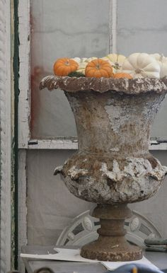 Simple rustic urn with pumpkins....lovely.