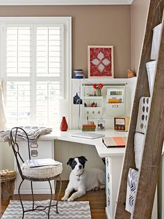 A corner desk utilizes space well in this small home office. Wall-mount storage keeps essentials close at hand yet organized. Sable-brown walls and white beaded-board wainscoting bring character to the space, while a chevron rug adds a trendy flair.