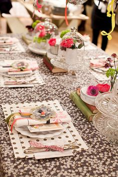 table setting, love the way the books are used integrated into the center piece. depending on how formal your celebration is, well will depend of your tablecloth and things. but this gives you another chance to think about ideas. just think out of the box, Walking on Sunshine:-)