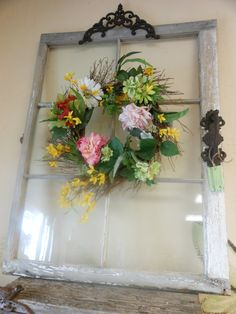 Vintage six glass pane window with original glass, added wrought iron hardware and wreath.