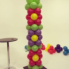 Balloon Flower Power Tower DIY Project.  Step by step tutorial on You Tube.  Perfect for flower themes, spring parties, Mothers Day, Easter, Tea Parties, etc