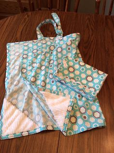 A personal favorite from my Etsy shop https://www.etsy.com/listing/256193810/nursing-cover-2-burp-cloths-set-trendy