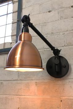 Industrial Swing Arm Wall Lamp with brushed copper shade and white inner