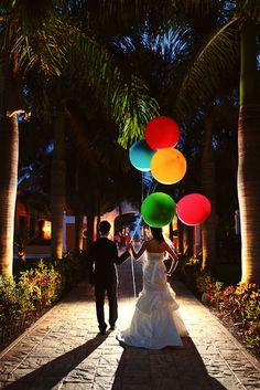 backlit bride and groom with balloons! // photo by rachel schrank of playaweddings
