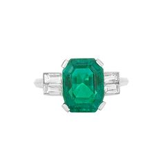 Platinum, Emerald and Diamond Ring Centering one cut-corner emerald-cut emerald approx 4.20 cts., flanked by 4 baguette diamonds approx .80 ct.
