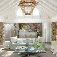 Lake House Living Room   Style Director Heather Chadduck painted the ceiling pale gray to open up this space.   SouthernLiving.com