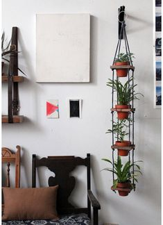Have decent light in your apartment but are lacking on the windowsill space? Check out this simple hanging planter idea that will keep things vertical with its towering tiers instead of filling every window ledge in your space with pots.