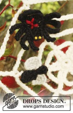 Crocheted spider, web and fly Halloween