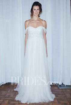 """Brides.com: Rosa Clará - Fall 2014. """"Comillas"""" beaded tulle empire wedding dress with off-the-shoulder and spaghetti straps, and a flowing skirt, Rosa Clará"""