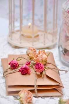 I have so many roses in my backyard-- perfect idea to top gifts with dried blooms!