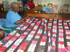 The widows in the Widow Care Center, Kenya making a yo-yo quilt