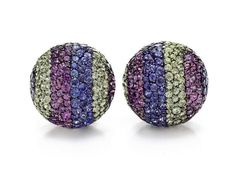 "A PAIR OF DIAMOND AND MULTI-COLORED SAPPHIRE ""BALL"" EAR CLIPS, BY JAR  Each of bombé design, pavé-set with blue, green and violet sapphires, enhanced by a line of circular-cut diamonds, mounted in 18k gold and silver, with French assay marks and maker's marks, in a JAR pink leather box $602,500.00"