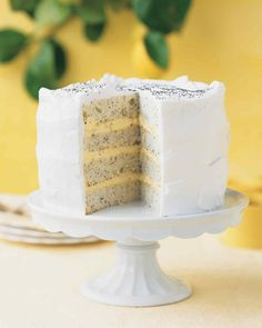 Nutty poppy seeds and fragrant lemon zest enliven a white layer cake; its filling is a combination of whipped cream and lemon curd.