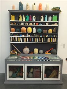 """Designer as Archaeologist, Mark Dion's """"Cabinet of Marine Debris"""". Taken from my visit to the Parrish Museum. I imagine Mark scanning the shore for glitches, irregularities in the stone, sand and water, with the fisherman setting their traps nearby, him reaching into the sludgy water to pull out a bottle cap or an empty PEZ container."""