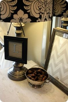 Love the frame hanging on the lamp