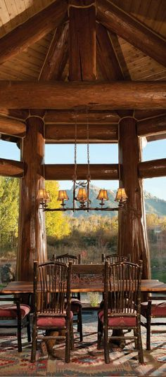 Alcove encased in glass and breathtaking hand-peeled-logs, provides panoramic views for an enjoyable dinner experience.
