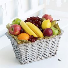 Fruit Basket with Chocolates. This generous selection of delicious fresh fruit is presented in an open willow basket. A classic gift for any occasion, this selection of fine fruits is sure to raise a smile.