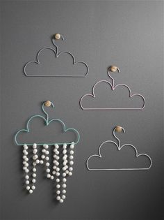 Wire Cloud Coat Hangers Perfect little clothes on perfect little cloud hangers. Available in adult sizes too. They make perfect room decor too, on their own or with some felt garland, the possiblities are endless! Specifications adult 28cm x 42cm. child 25cm x 15cm. powdercoated metal.