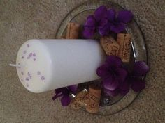 Center pieces for my cousins bridal shower. 3x4 pilar candle, customized wine corks and purple flowers! Loved them!!