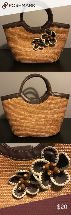 Ann Taylor Loft Straw Bag Ann Taylor Loft Straw Bag. Cute flower decorations on the front. Snap closure. Inner pockets. Interior is in very good condition. Very cute bag for spring and summer! LOFT Bags Totes