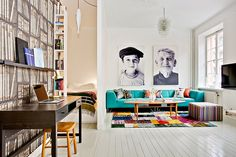 Amazing space with or without furniture, but I love the big black and white portraits!