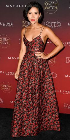 Alexandra Shipp attended People's Ones to Watch event in this gorgeous ensemble. The actress donned a floor-length red floral dress with minimalistic straps and sans jewelry, except for a simple red bracelet worn around her arm.