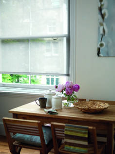 Combine Neutral Roller Blinds With Natural Wooden Furniture And Lots Of Fresh Plants
