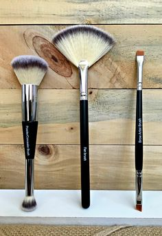 Our new powder concealer/highlighter brush, Fan brush and brow liner brush. Perfect brushes for perfect faces. www.LookingLashtastic.com