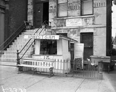 Mrs. O'Leary's house at 558 West DeKoven with a hotdog stand out front. Although she has been cleared, this is the legendary site of the start of the Chicago Fire of 1871. Sadly Mayor Richard Daley (the first) had it torn down. The site now houses the fire department academy. 1954