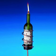 Roomie told me about this - totally doing it!  Copper Wine Bottle Tiki Torch Kit