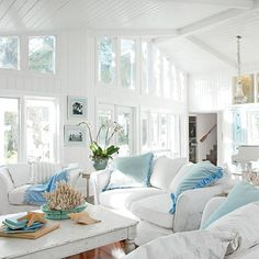 coastal decorating with white sofas and sealife