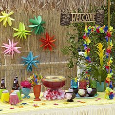"Throw a Hawaiian Luau Party -   Love the foam ""grass skirts"" on the cans!  Could it puy on soda or water bottles for the kids--so easy to make!!"