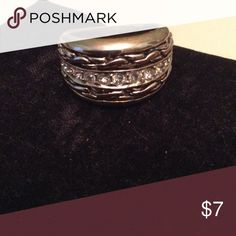 Fashion band ring Swarovski elements sz. 6 Wide silvertone band rink with a tint of gold tone through the robe design. Embellished with a row of Swarovski crystal stones. Size 6 Jewelry Rings