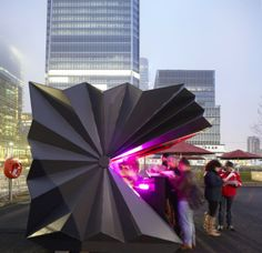Architects re-imagine kiosk as fan-like folding structure By Stuart Robarts February 10, 2014 The kiosks in use at Canary Wharf