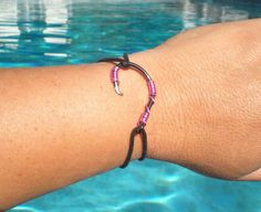 PINK ON BLACK Fish Hook Bracelet via Etsy.