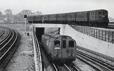 Description: Up Metropolitan fast train crossing Stanmore line fly-under at Wembley Park with down Stanmore tube train in foreground London Underground Train, London Underground Stations, Metropolitan Line, Tube Train, Metro Rail, London Transport Museum, Vintage London, Portugal Travel, London Calling